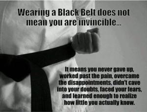 wearing_black_belt